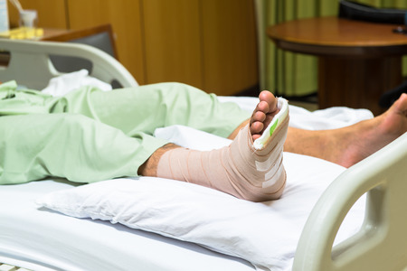 Patient with broken leg in cast and bandage  photo