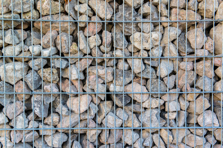gabion mesh: Detail shot of a stone retaining wall