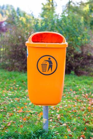 Orange plastic dust bin photo