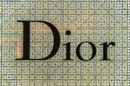 chaired: BANGKOK - APRIL 4   The sign of Dior at Dior store on Apr 4, 2014 in Suvarnabhumi Bangkok, Thailand  It is a French company controlled and chaired by Bernard Arnault who also heads Louis Vuitton
