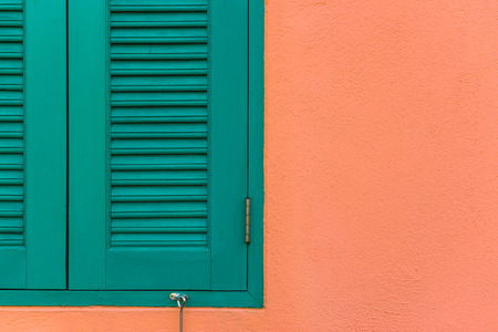 Italian style shutters in an old house photo