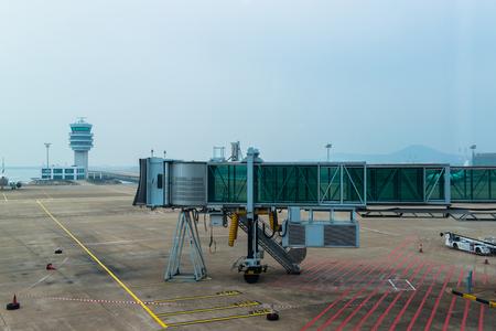Japan - Circa 2014:  landing airplanes, waiting for takeoff permission aircrafts on runway, loading and unloading luggage at Narita International Airport, Japan
