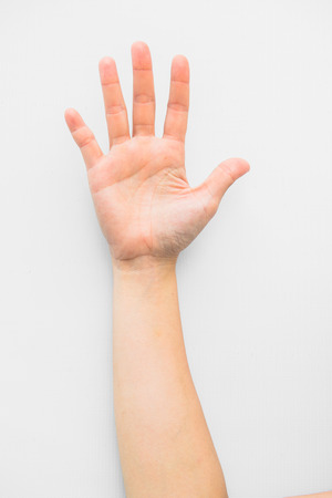 a close up: hand sign isolated on white background Stock Photo