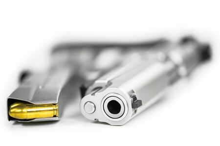arsenal: Bullets with the gun Stock Photo