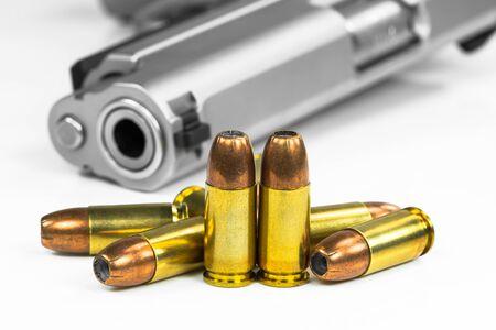 pistolas: Puntos negros con el arma Foto de archivo