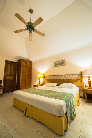 south male atoll: Interior of the tropical villa bedroom in South male atoll of Maldives Stock Photo