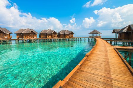 bungalows: Over water bungalows with steps into amazing green lagoon
