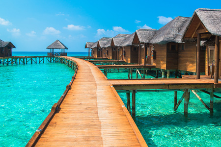 polynesia: Over water bungalows with steps into amazing green lagoon
