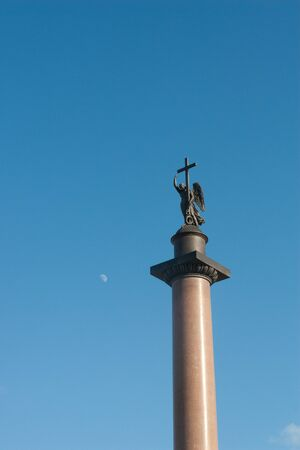 Angel statue on a pillar holds cross in Russia