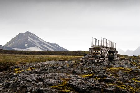 Wooden bridge in landscape along hiking trail in iceland
