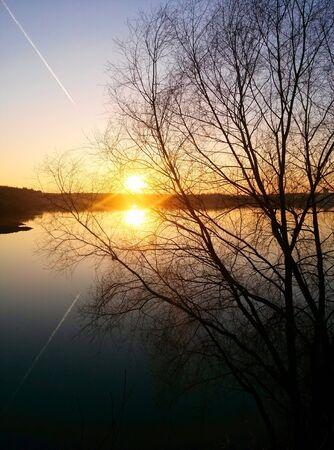 reflecting: Romantic sunset on reflecting lake