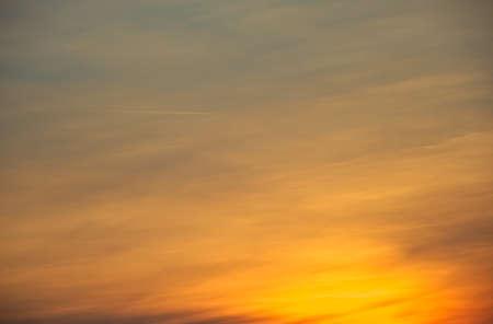 shrouds: Slightly cloudy, warm sunset with orange light