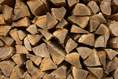 stack of firewood: Stack of firewood splitted in pieces trianular