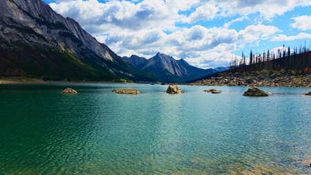 Rocky lake in front of mountains Stok Fotoğraf