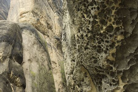 holey: Eroded holey rockface out of sandstone