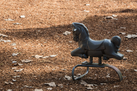 gray horse: A gray horse toy at the playground Stock Photo