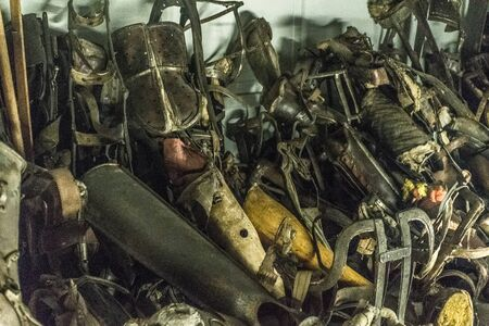 Oswiencim, Poland - September 21, 2019: Pile of prostheses in former German Nazi Concentration and Extermination Camp Auschwitz-Birkenau.