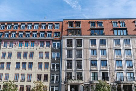 Berlin, Germany - September 23, 2018: Intersting and parallel architecture of two side by side and colorful buildings with a lot of windows reflecting the sky in the center of Berlin, Germany