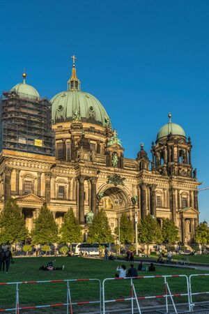 BERLIN, GERMANY - SEPTEMBER 26, 2018: Horizontal view of the wide and famous landmark, Berliner Dom, the Cathedral of Berlin, located near the Spree river and highlighted by the sunset