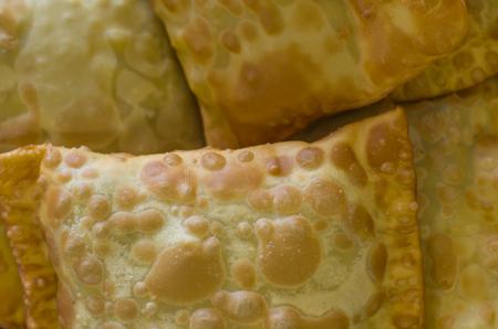 Texture of traditional Brazilian pastel. Pastry. Banco de Imagens