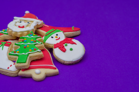 Great christmas background, christmas biscuits on white plate with blue background