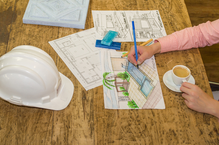 Woman working, projecting on table, architect, engineer.