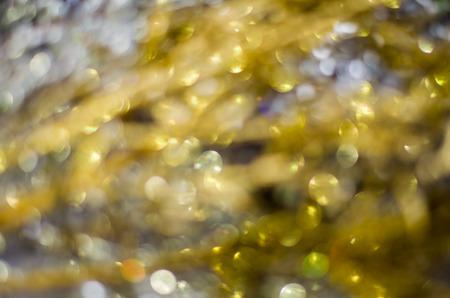 Golden bokeh texture, Blurred texture of golden glitter for backgrounds. Imagens