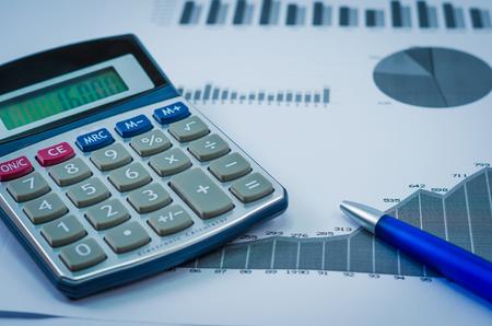 Pen, graphs, calculator, finance concept, home economics. Banco de Imagens