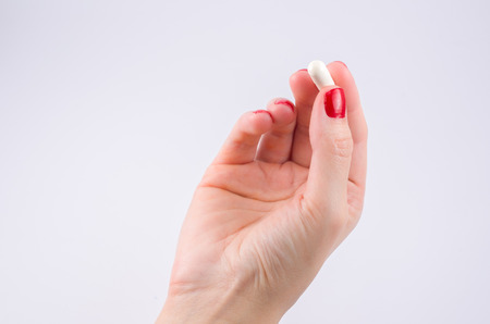 Hands of woman with prescription pills on the palm medical treatment.