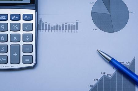 Pen, graphs, calculator, finance concept, home economics.