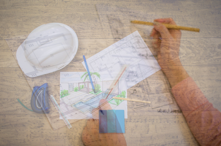 Double exposure of woman working on architectural projects