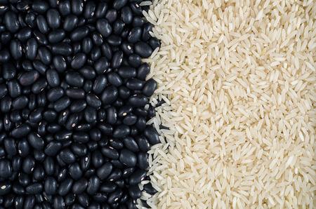Raw food, raw black beans, rice, vegan, background, texture.