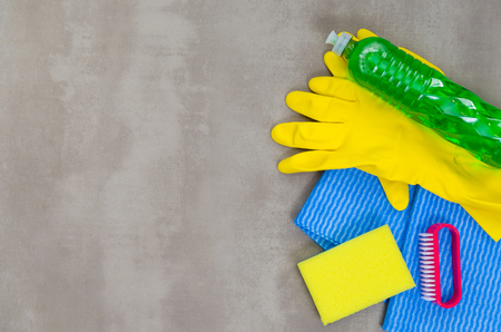 Great concept of cleaning, various products used in cleaning on gray background. Stock Photo