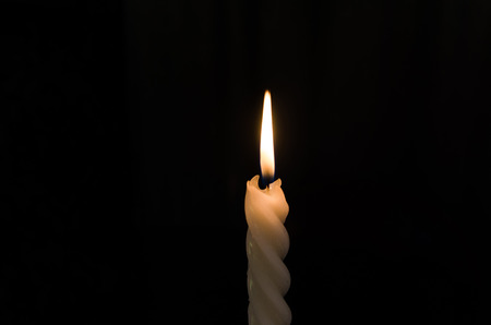 The flame of the candle that illuminates the bright red light at the point of making merit or praying on the holy day  various sacrificial ceremonies - Imagem