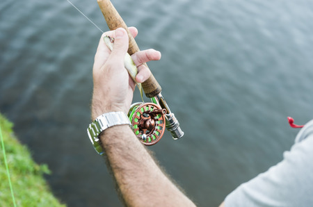 Flyfishing on the lake in Brazil, young fisherman fishing.