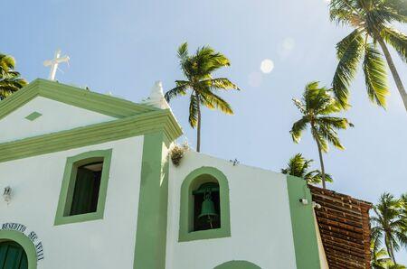 Beautiful view of (Capela de São Benedito) Chapel of St. Benedict and Carneiros Beach (Praia dos Carneiros), Pernambuco, Brazil. Secular Chapel of Carneiros Beach. Church in the beach with palm trees.