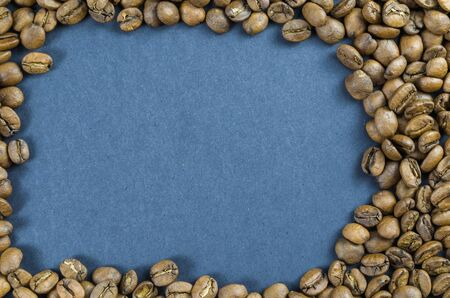 Texture, background of whole coffee beans, raw.