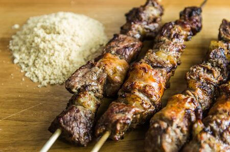 Juicy meat barbecue skewer (Churrasquinho, skewer) in close up.