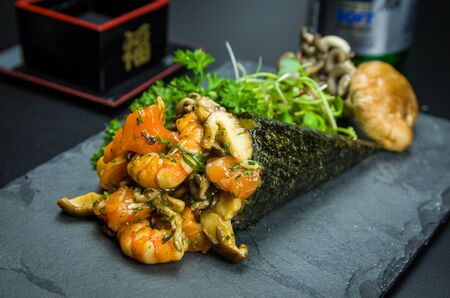 Sushi. Traditional Japanese cuisine, premium Temaki of mushrooms, shrimp and salmon, decorated in an elegant setting.