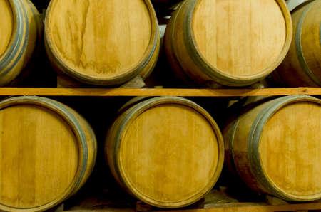 Oak barrels for wine aging in an underground cellar in Vale dos Vinhedos