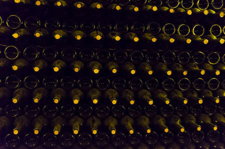 Wine bottles stored in the underground cellar for aging.