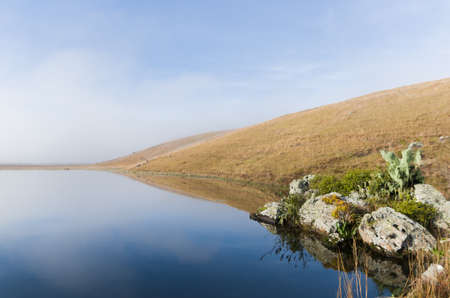 Beautiful lake landscape in a foggy day.