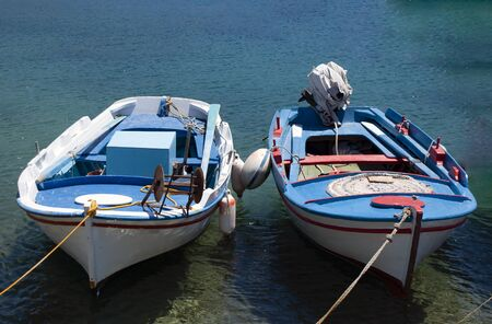Traditional colorful wooden fishing boats at the Greek island of Donoussa. A quiet island in the Cyclades, close to the larger island of Naxos. Stock fotó
