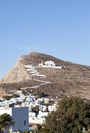 Greece – Folegandros island. A view of the Church of our Lady, high on a hill over the islands main town.