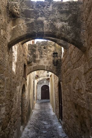 The Jewish quarter in the old town of Rhodes. A Greek island with the oldest, still lived in, medieval city in Europe. Picture of the Jewish quarter, which has little tourism and is very quiet. Banco de Imagens