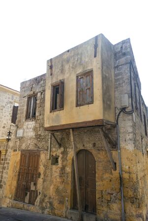 The Jewish quarter in the old town of Rhodes. A Greek island with the oldest, still lived in, medieval city in Europe. A balconied old Turkish house in the Jewish quarter. Banco de Imagens