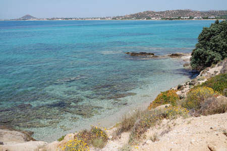 Naxos island Greece. Beautiful seascape over crystal clear blue waters to distant beaches. Mikri Viglia village on sandy south west coast. Copy space.