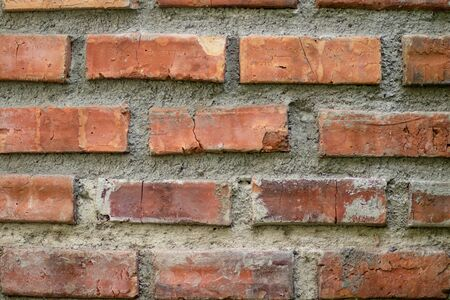 Close-up details of a orange-brown brick wall. red brick wall close up, old brick background. red brick wall. vintage style.