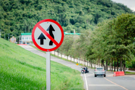 Do Not Overtake Traffic Sign. Road signs forbidden to overtake the mountain. Mountain road. Stock Photo