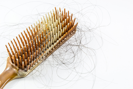 combs: Long hair falls in a hair brush Stock Photo